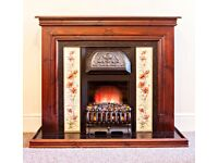 Victorian style fireplace with wooden mantelpiece, tiled surround and insert electric fire
