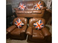 Lovely nice and compact Brown leather 3 seater sofa and 2 matching chairs very comfy