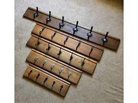 Hand forged blacksmith hooks on reclaimed oak