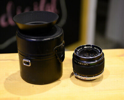 Olympus Zuiko 28mm 1:2.0 with case and hood