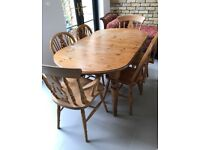 Ercol Pine Table (1985) with 8 Chairs ( 2 are Carvers)