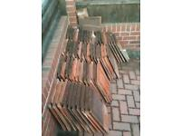 Free roof tiles taken down from porch roof