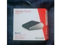 Microsoft Wedge Touch Mouse.