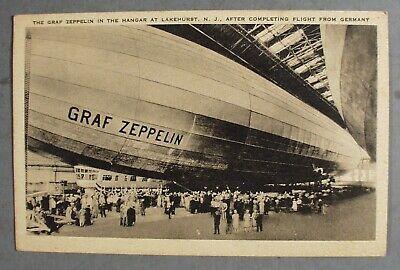 POSTCARD GRAF ZEPPELIN IN HANGER LAKEHURST N.J. AFTER FLIGHT FROM GERMANY