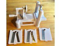 Spiralizer - Unused. 3 settings; slices, big spaghetti / noodles, small spaghetti. Suction pad feet.