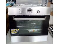 New and unused Zanussi oven, hob and integrated extractor hood with aluminium splash back and hood.