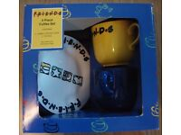 Friends 4 piece coffee set of large cups and saucers set never used and boxed in great condition.