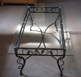 Heavy glass top coffee table, bevel edge with metal scroll base 1200x620mm