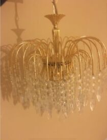 2 gold Crystal chandeliers