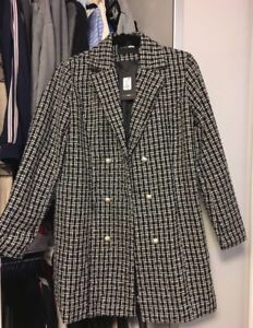 Double breasted coat size S. Never worn . Tag still on