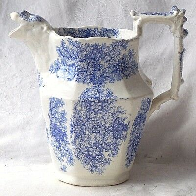 C19TH STAFFORDSHIRE BLUE AND WHITE TRANSFER PRINTED JUG WITH LIONS HEAD SPOUT