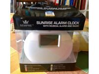 Unused Sunrise Alarm Clock with musical alarm and radio.