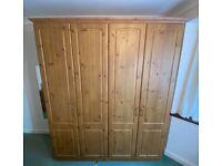 Large, pine effect wardrobe