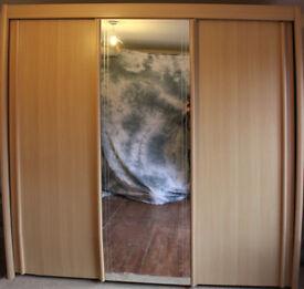 PALE OAK EFFECT TALL SLIDING DOOR WARDROBE WITH MIRROR