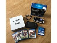 PS Vita & 4 games Case boxed as new PSVita