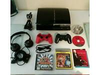 Sony ps3 60gb backward compatible ps2 games 2 controls and more!!