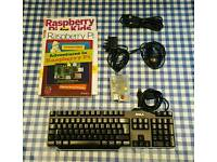 Raspberry Pi + keyboard + mouse + HDMI lead + magazines