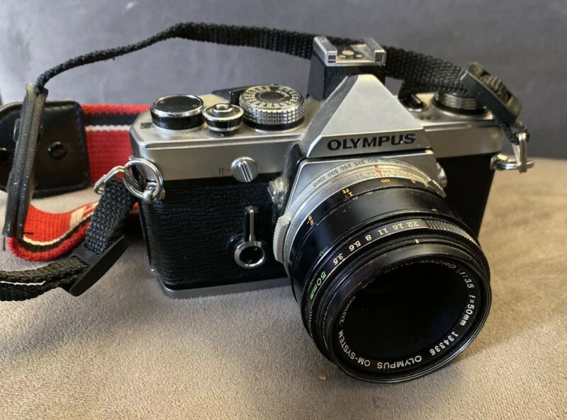 OLYMPUS OM-1n 35mm SLR with Zuiko 50mm Lens. Great Condition.