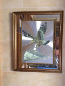 Mirror with eagle image in centre
