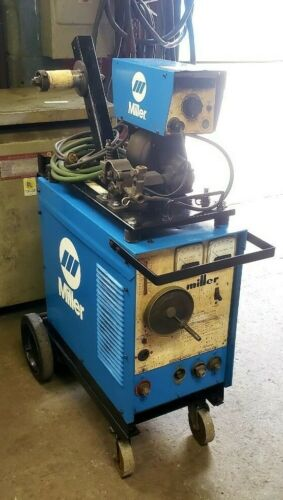 USED MILLER CP-200 WITH 30E FEEDER