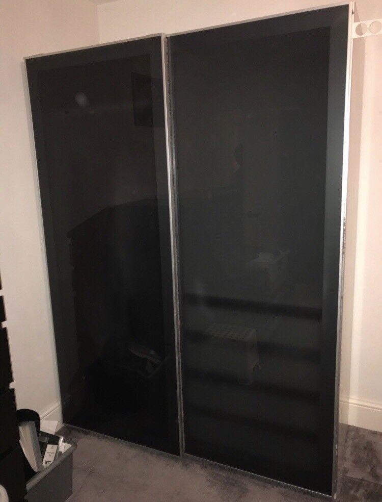 ikea pax white double sliding wardrobe with black glass. Black Bedroom Furniture Sets. Home Design Ideas