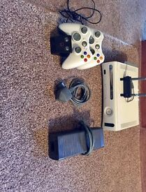 Xbox 360 with 69 games, 2 controllers, controller charging station and more.