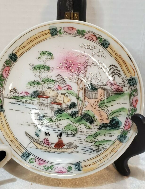 Japanese Hand Painted Porcelain Tea Cup And Saucer