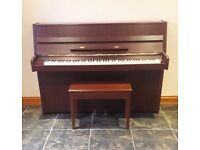 Upright Eterna Piano made by Yamaha