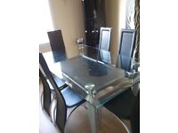 Silver and black table with 6 chairs.