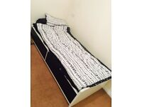 Single IKEA bed with mattress and 2 drawers - like NEW