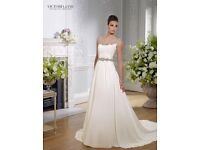 Designer ivory wedding dress size 14