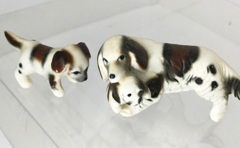 Vintage French Brittany Spaniel dog figurine carrying puppy in mouth (2 puppies)
