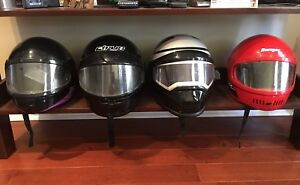 4 snowmobile or motorcycle helmets