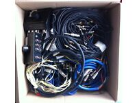 Box of various studio leads including XLR to jack loom, phono to jack loom, jack to jack loom.