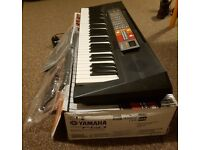 Yamaha PSR F50 Portable Keyboard, Almost New, with Music Stand and Manual.