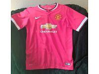 Bundle of 8 Manchester United shirts.