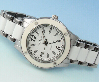 AK ANNE KLEIN Women's 10-9181WTSV White Enamel & Silver-Tone WATCH