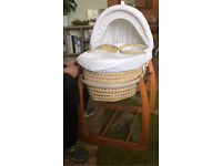 White Mamas and Papas Moses basket with wooden rocking stand