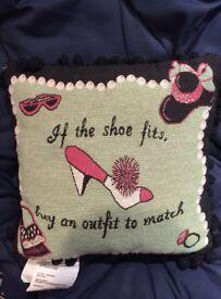 Woven 'shoe' design cushion.