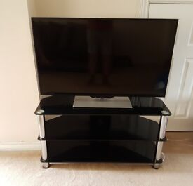42 inch smart TV and glass stand