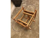 Gliding mother care stand and Moses basket