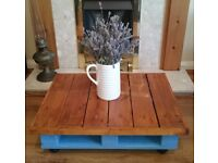 Upcycled, hand-crafted pallet table with trolley wheels.