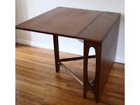 Foldable leaf dining table