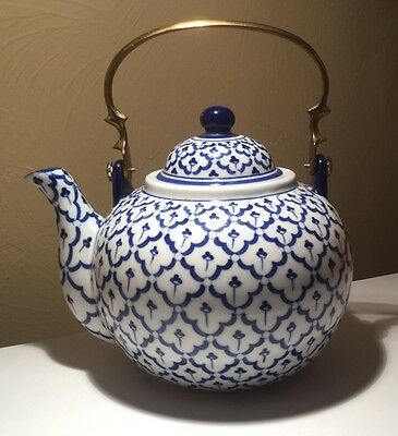 Blue And White Teapot With Brass Handle