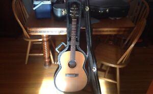 Concert size acoustic guitar