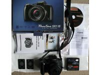 Canon PowerShot SX1 IS Digital Camera - Bundle (10MP, 20x Optical Zoom) 2.8 inch LCD