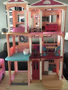 Barbie house and camper.