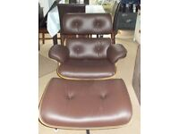Brown leather Eames chair and ottoman great condition