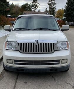 As is white Lincoln Navigator 2006. Leather