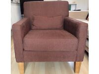 Modern brown armchair c/w small cushion.